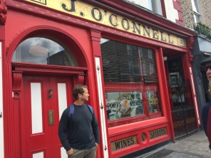 Mike stands in front of a colorful storefront in the heart of Dublin.